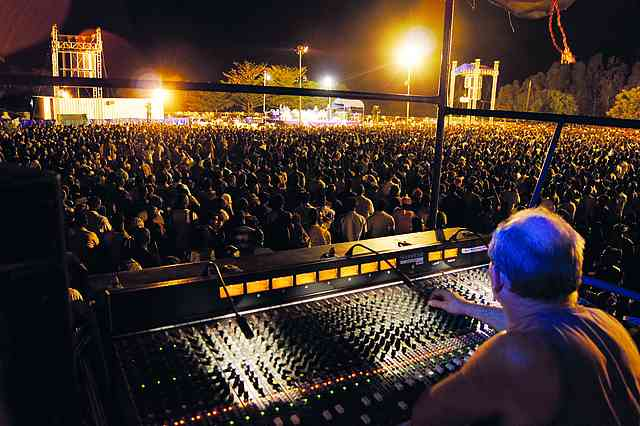 To achieve the best sound possible, the main mixing desk is set up in the middle of the field, about 100 meters from the stage.